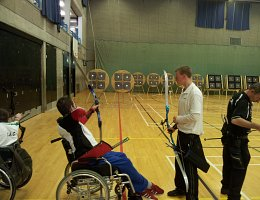 Man in wheelchair at archery